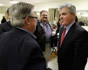 hoto by John Dunn   Newly elected Suffolk County Executive Steve Bellone, right, greets Chamber of Commerce members from across Suffolk County at a small business roundtable Monday at the VFW in Kings Park.
